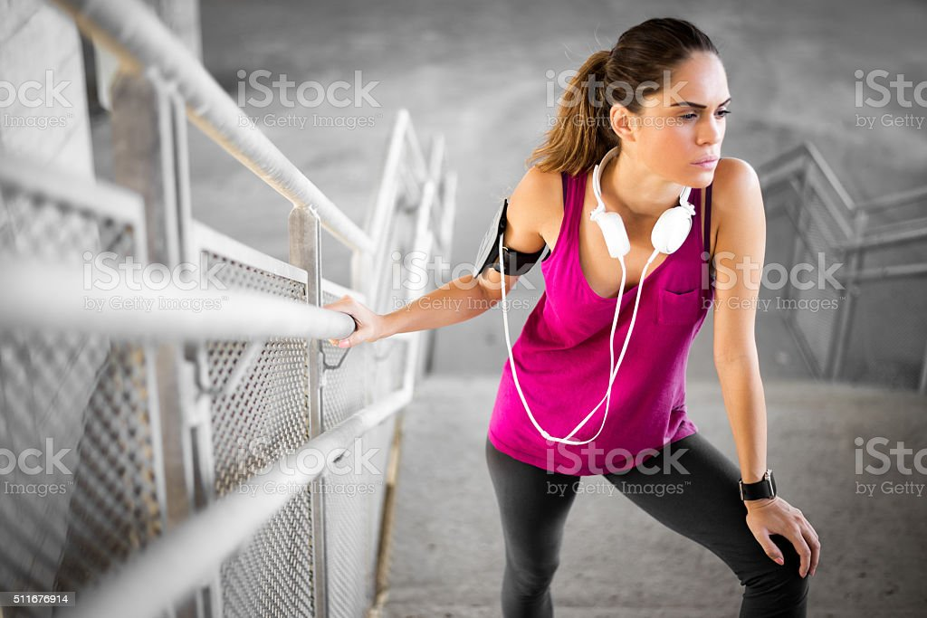 Sportswoman with MP3 player and headphones stock photo