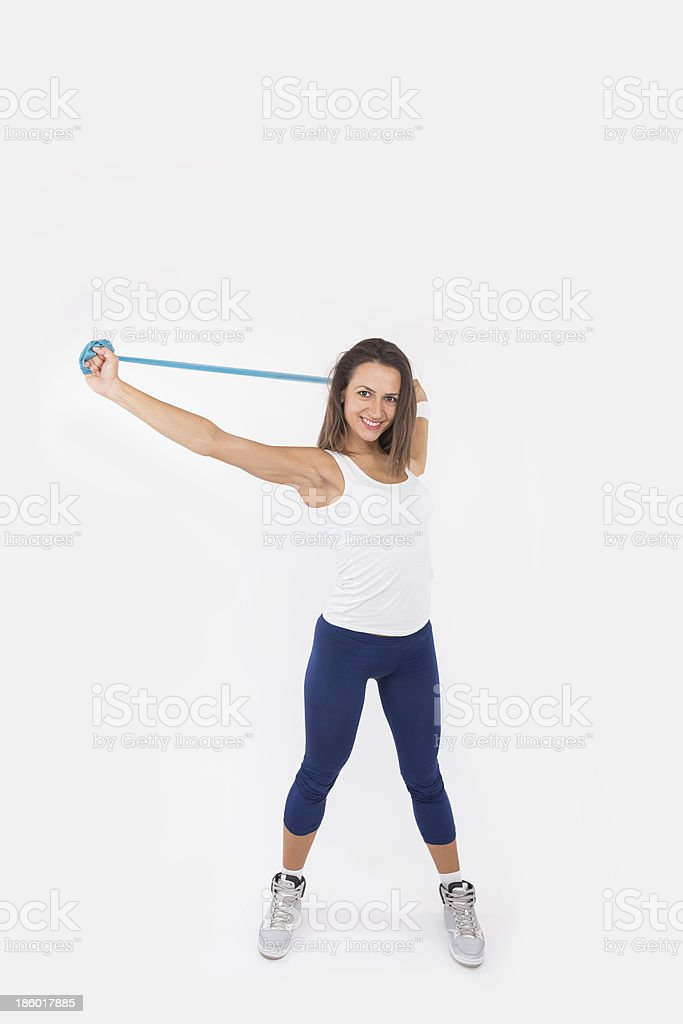 Sportswoman with resistance band royalty-free stock photo