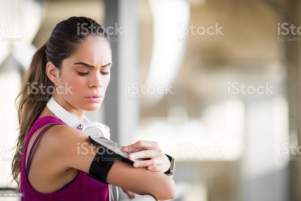 Sportswoman with wearable devices stock photo