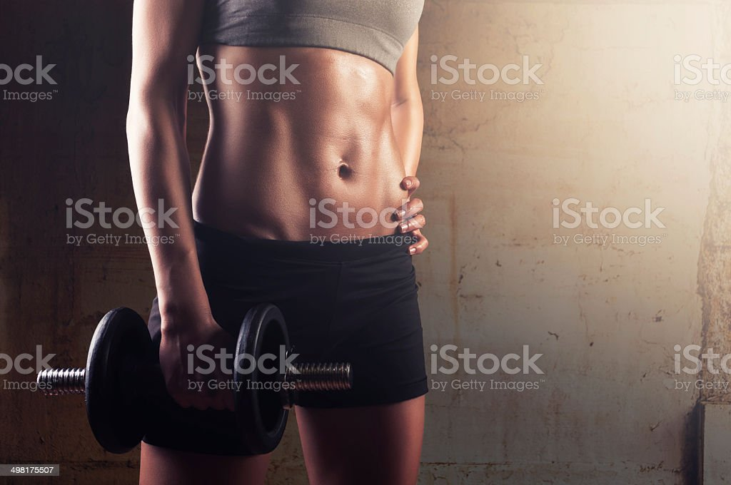 Sporty athletic woman in training stock photo