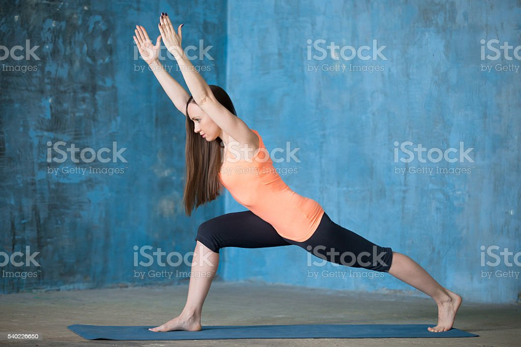 Sporty beautiful young woman practicing yoga stock photo