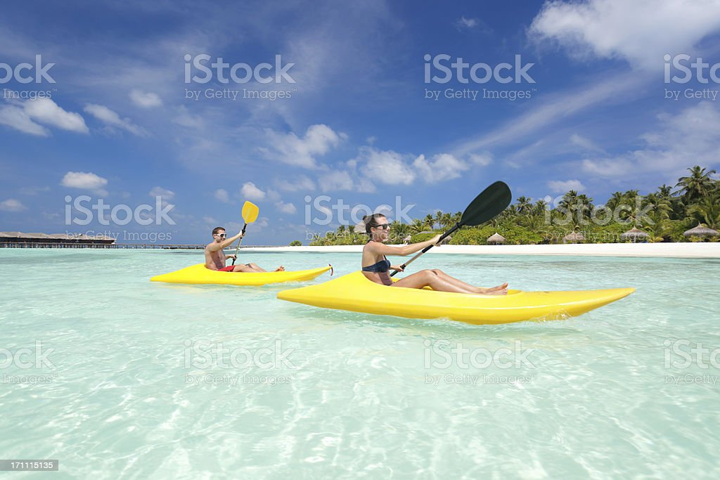 sportive couple kayaks stock photo