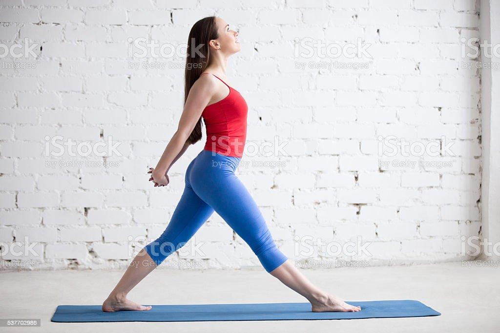 Sporty female doing stretching exercise stock photo