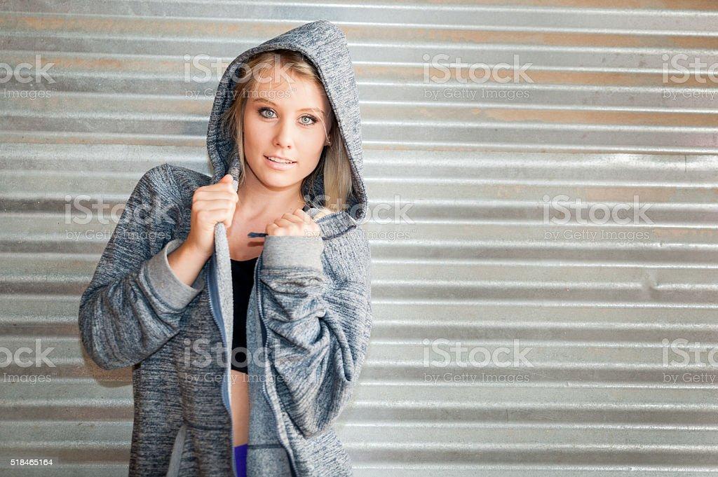 Sporty female wearing a hooded sweatshirt stock photo