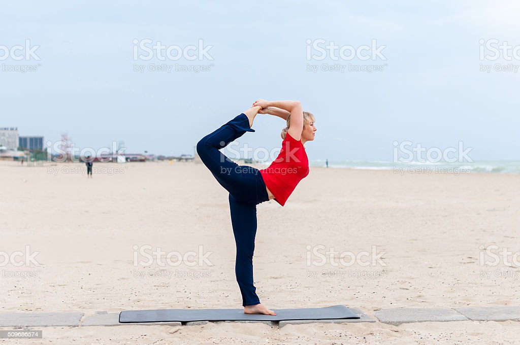 Sporty fit blond woman in red and dark blue sportswear stock photo