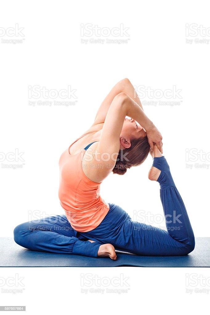 Sporty fit yogini woman doing yoga asana Eka pada kapotasana stock photo