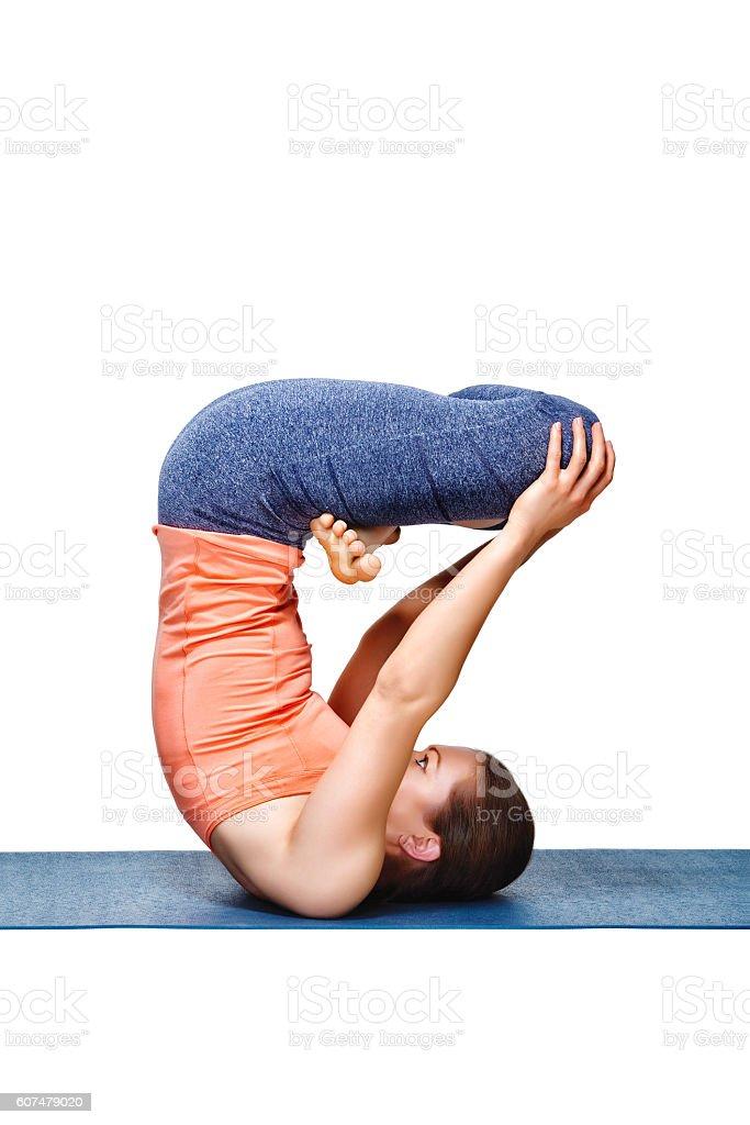 Sporty fit yogini woman practices inverted yoga asana stock photo