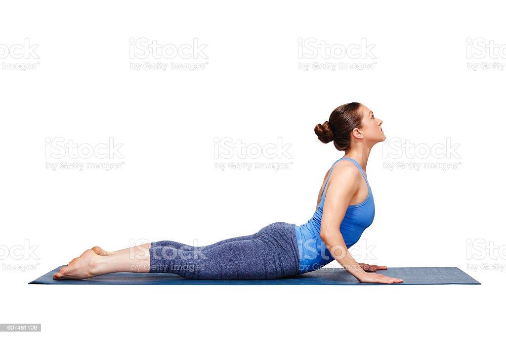 Sporty fit yogini woman practices yoga asana bhujangasana stock photo
