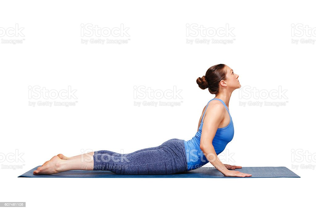 Sporty fit yogini woman practices yoga asana bhujangasana stock photo