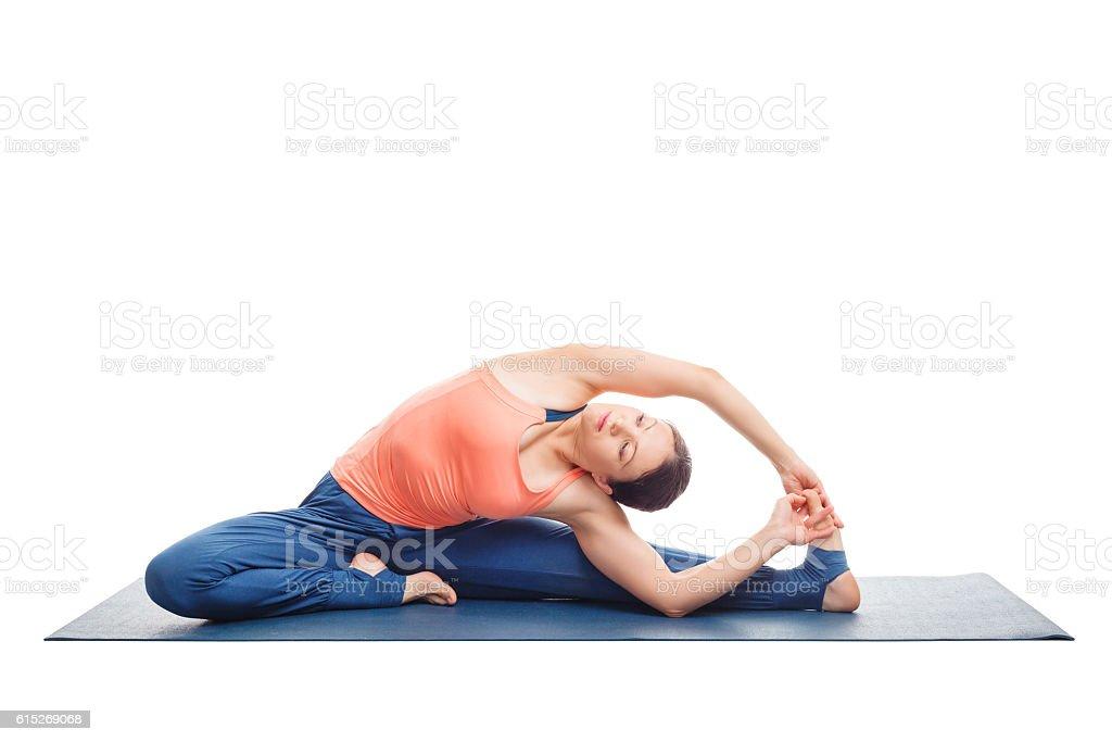 Sporty fit yogini woman practices yoga asana parivrtta janu sirs stock photo