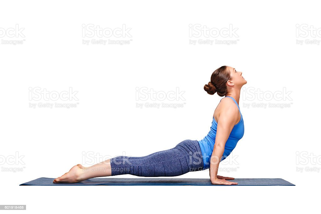 Sporty fit yogini woman practices yoga asana Urdhva mukha svanas stock photo