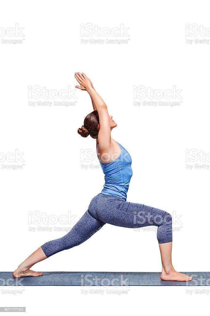 Sporty fit yogini woman practices yoga asana utthita Virabhadras stock photo