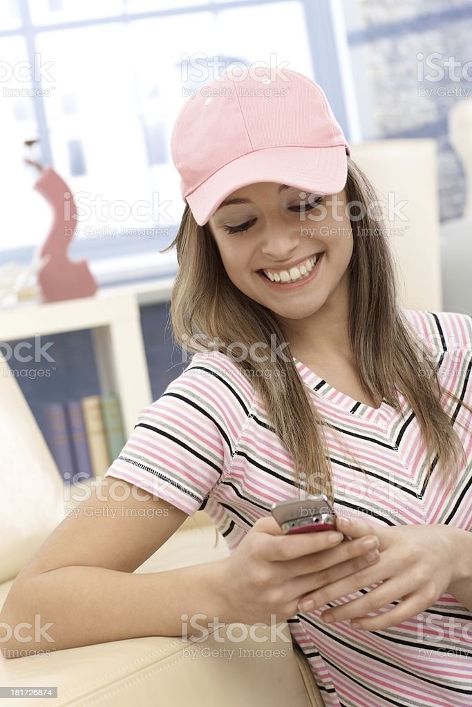 Sporty girl using mobile phone smiling stock photo