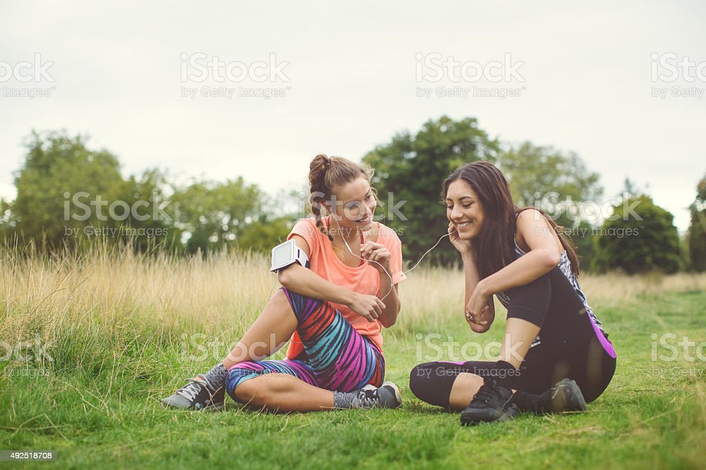 Sporty girls resting in Hyde park stock photo
