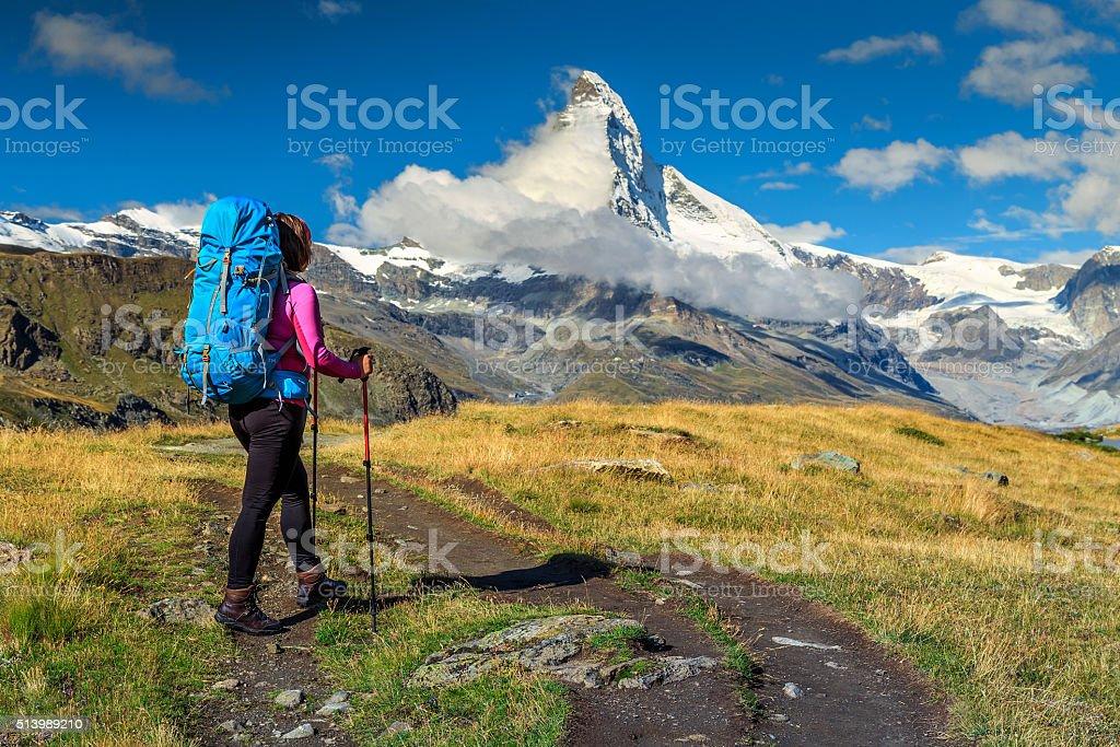Sporty hiker woman with Matterhorn peak in background,Valais,Switzerland stock photo