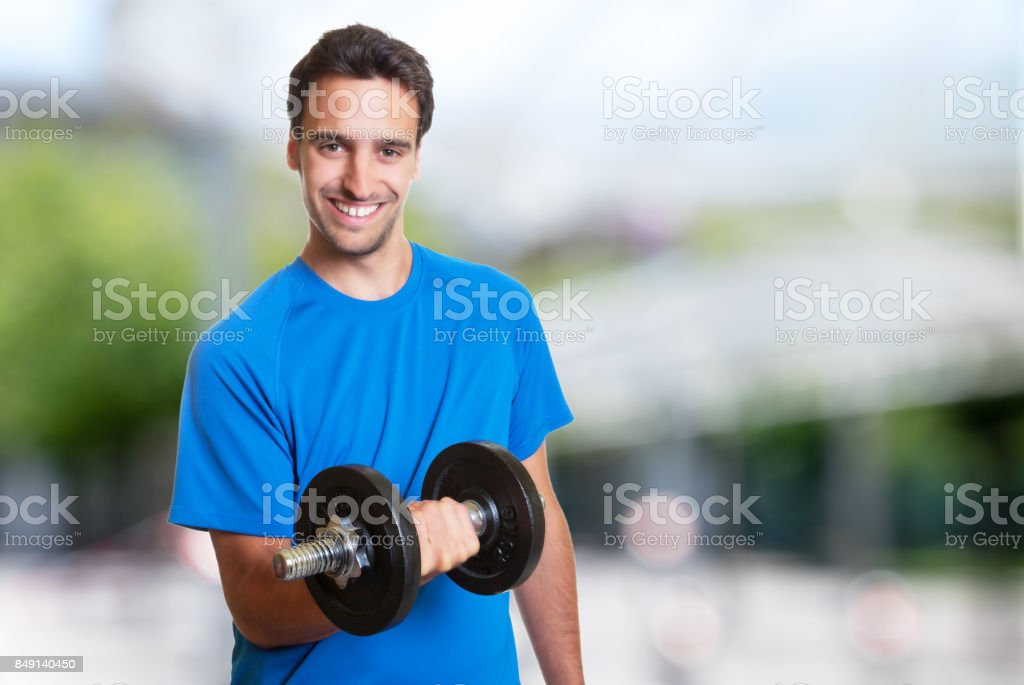 Sporty hispanic man at workout stock photo