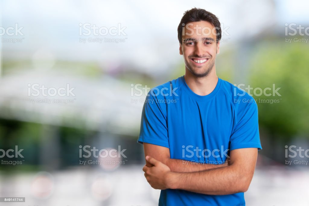Sporty hispanic man with beard looking at camera stock photo
