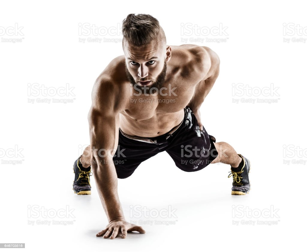 Sporty man doing push-ups exercises from the floor on the right arm stock photo