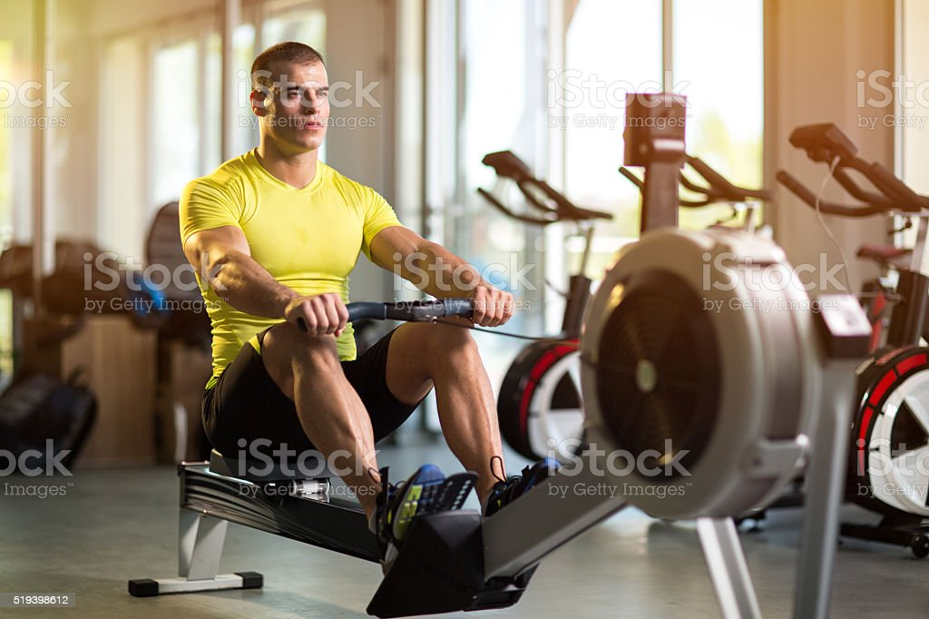 Sporty man exercising in gym stock photo