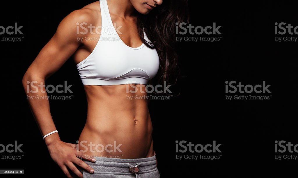 Sporty model with perfect abs stock photo