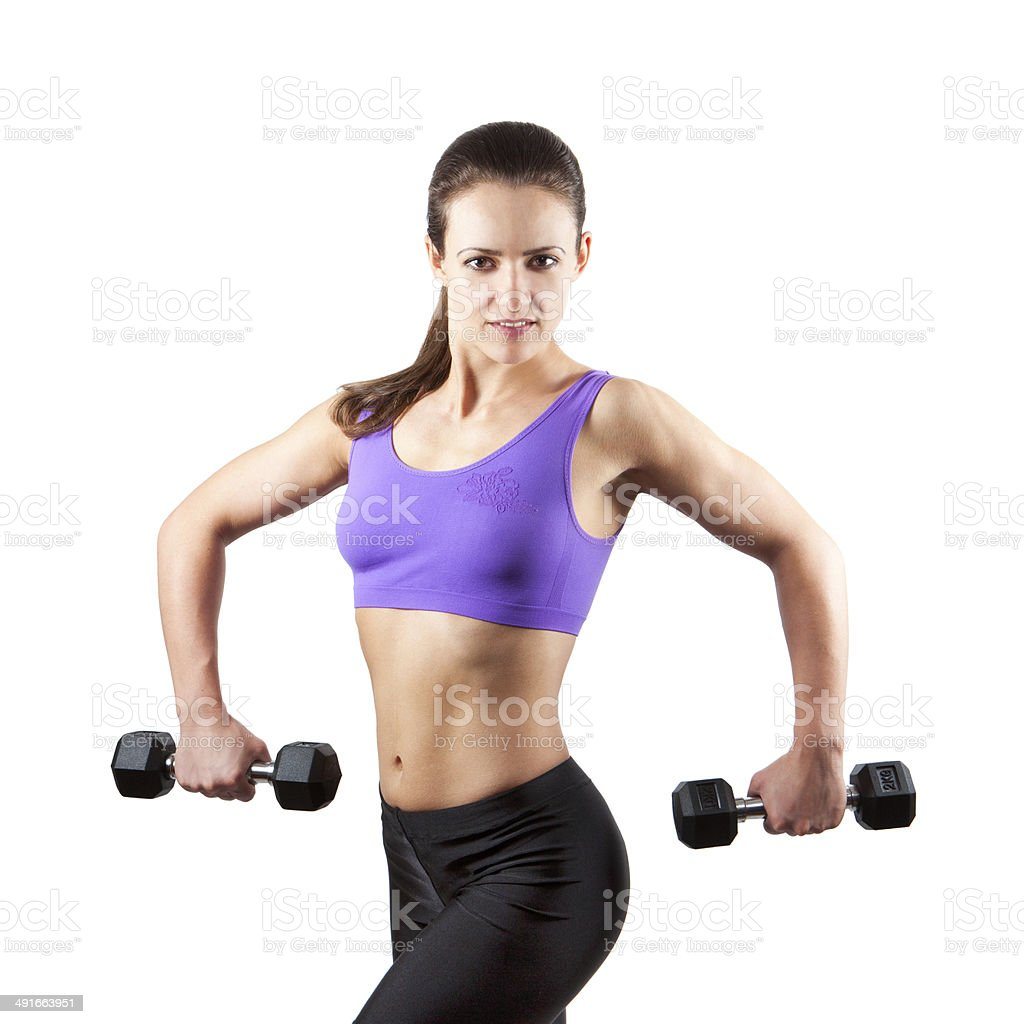Sporty muscular woman with two dumbbells stock photo