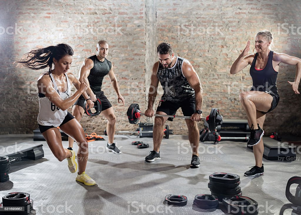 sporty people  practicing with weights stock photo