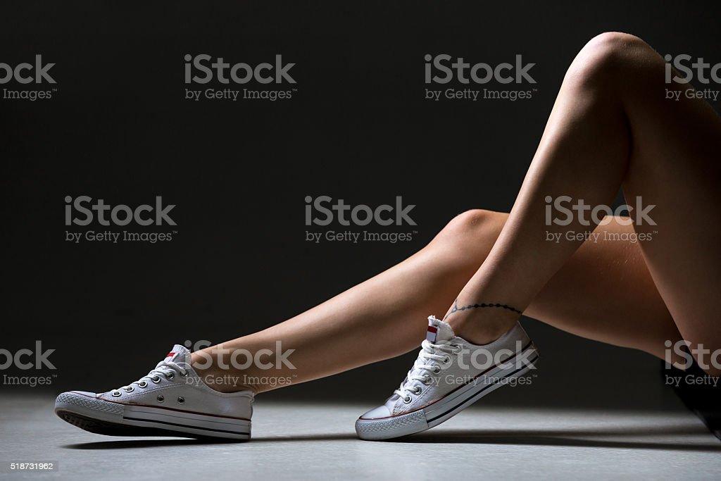 Sporty woman beautiful legs stock photo