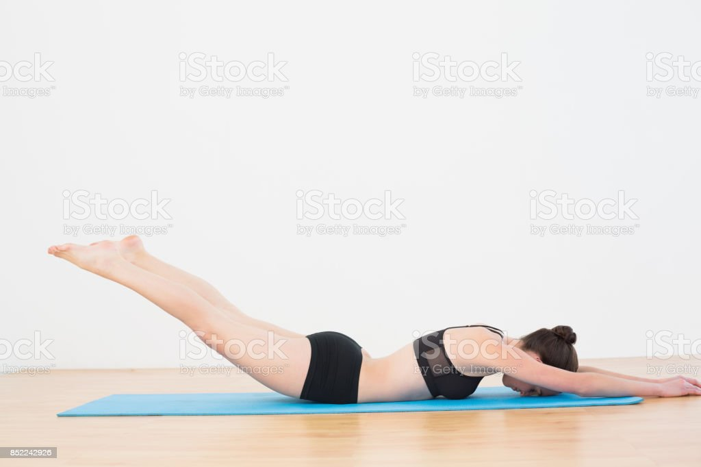 Sporty woman doing the Locust Posture stock photo