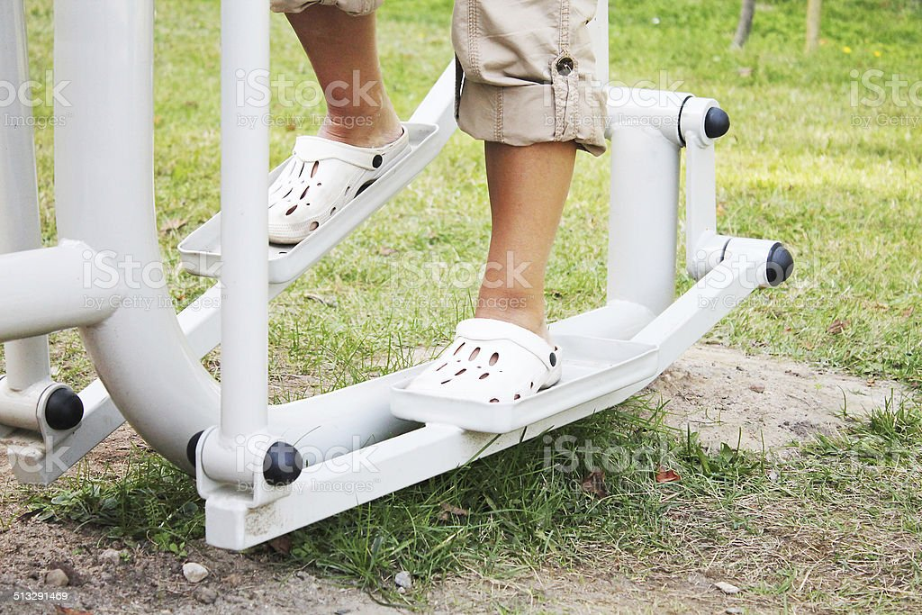 Sporty woman exercising on step machine stock photo