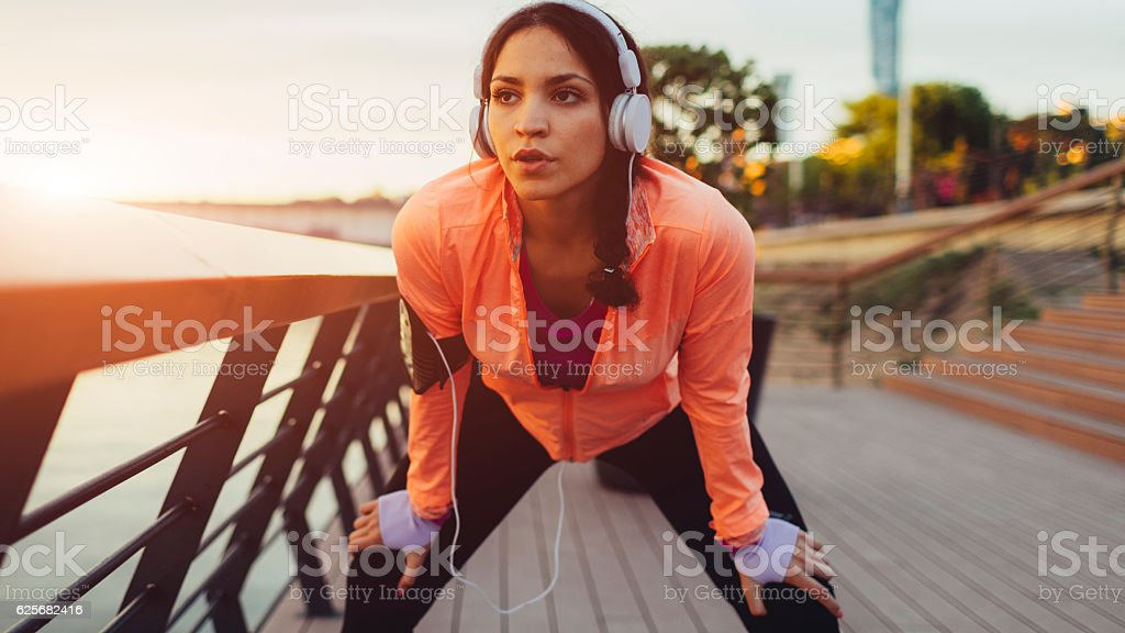 Sporty Woman Exhausted After Exercise. stock photo