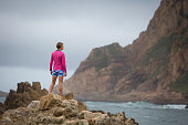 Sporty woman from behind admiring the view