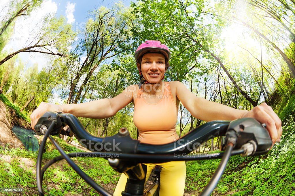 Sporty woman holding on handlebar of her bike stock photo