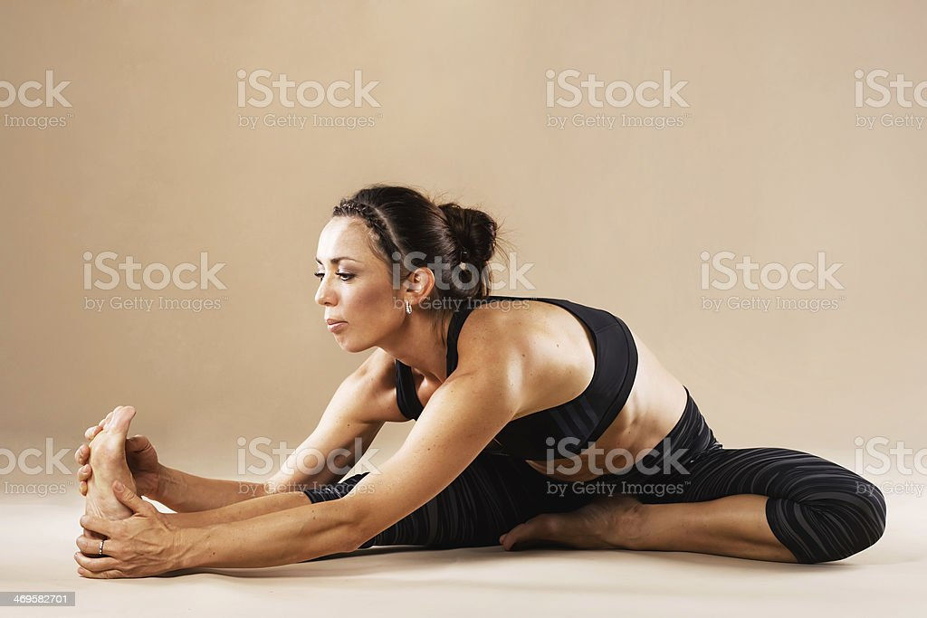 Sporty woman is working out stock photo