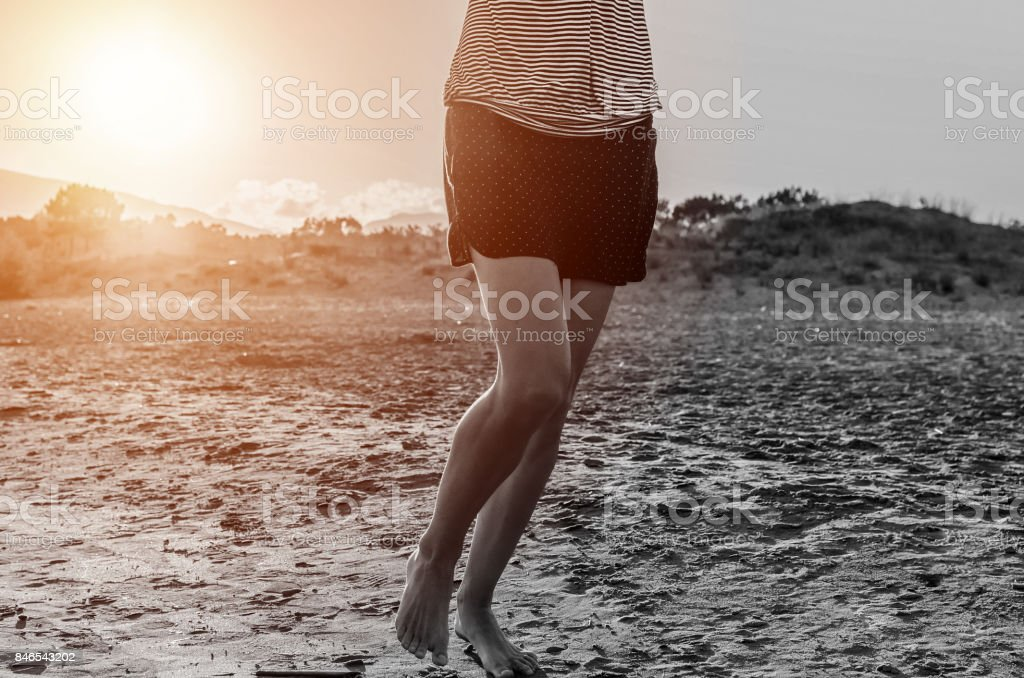 Sporty woman jogging in morning stock photo