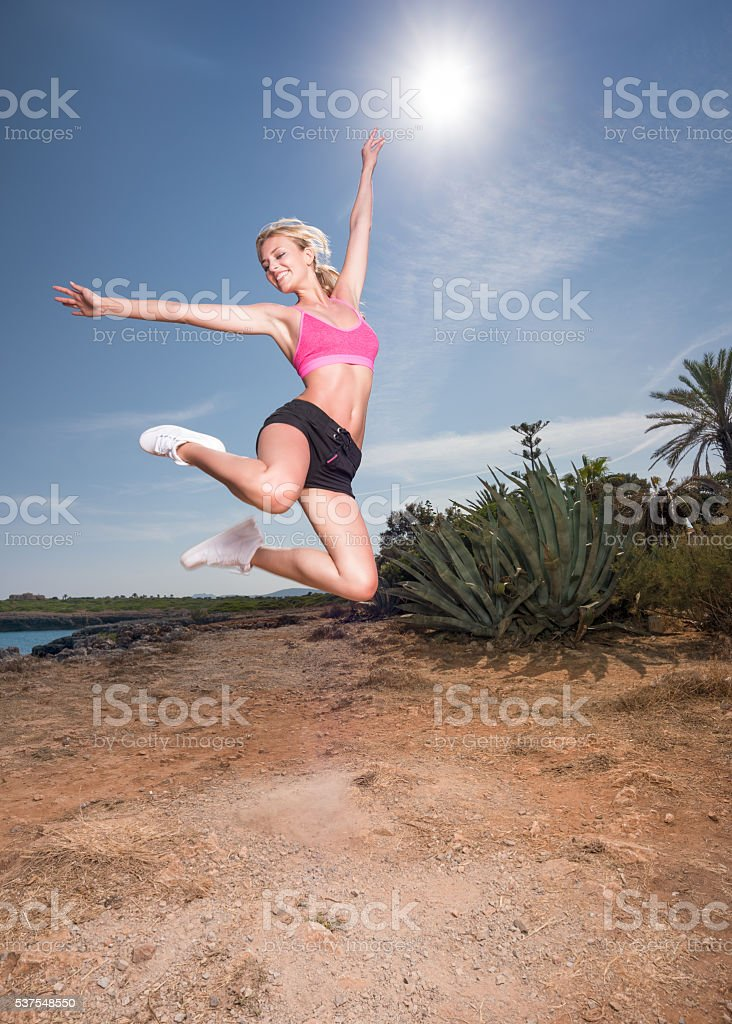 Sporty Woman jumping Outdoor, Lifestyle stock photo