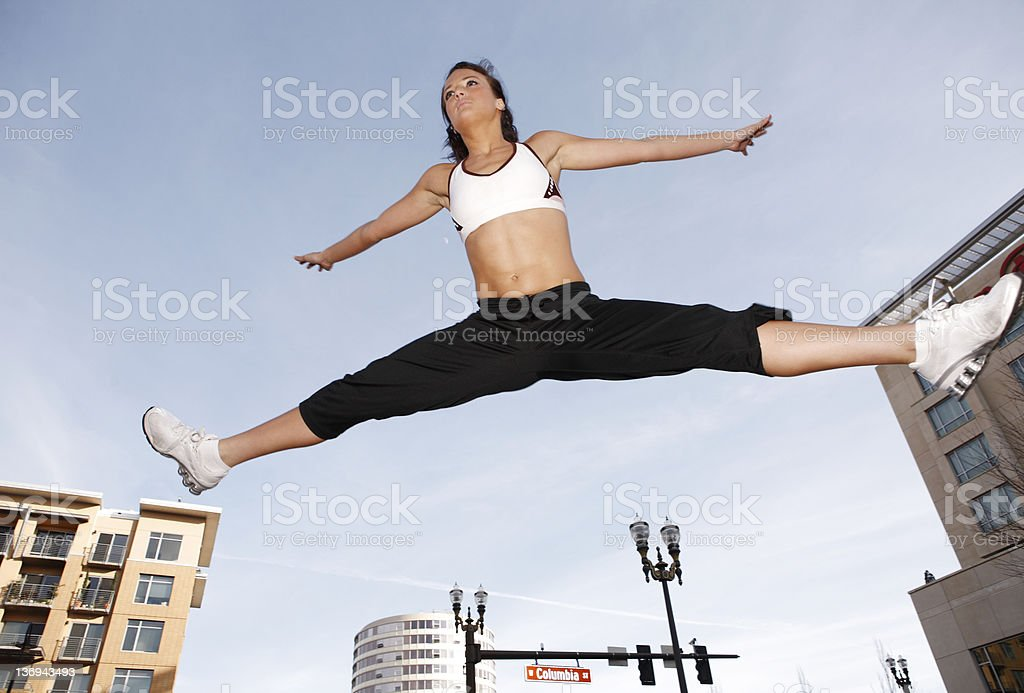 Sporty woman jumping royalty-free stock photo