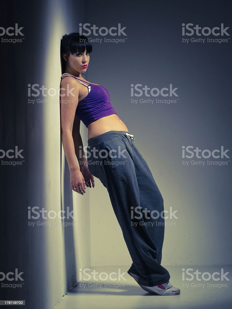 Sporty Woman Leaning On Wall stock photo