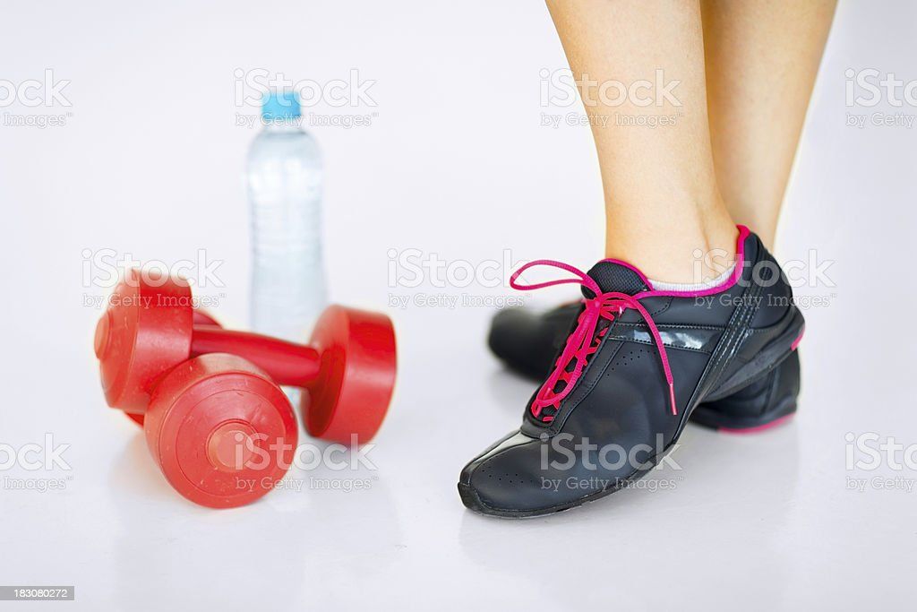 sporty woman legs with light red dumbbells royalty-free stock photo