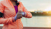 Sporty Woman Looking At Her Smart Watch.