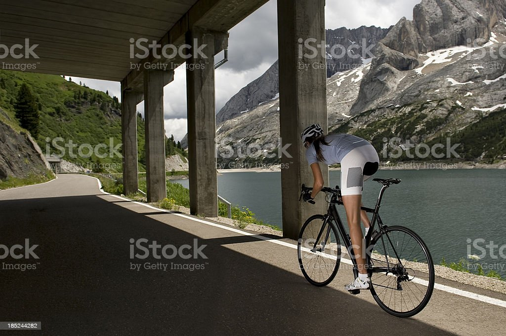 Sporty woman on racing bicycle royalty-free stock photo
