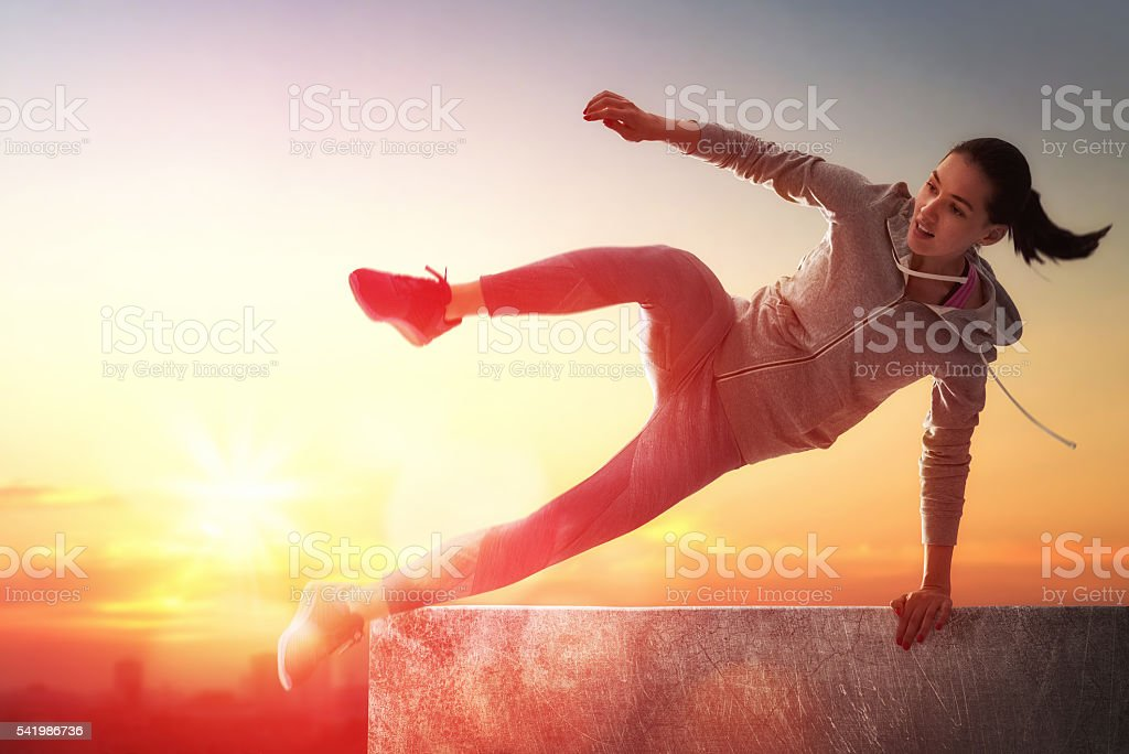 sporty woman outdoors stock photo
