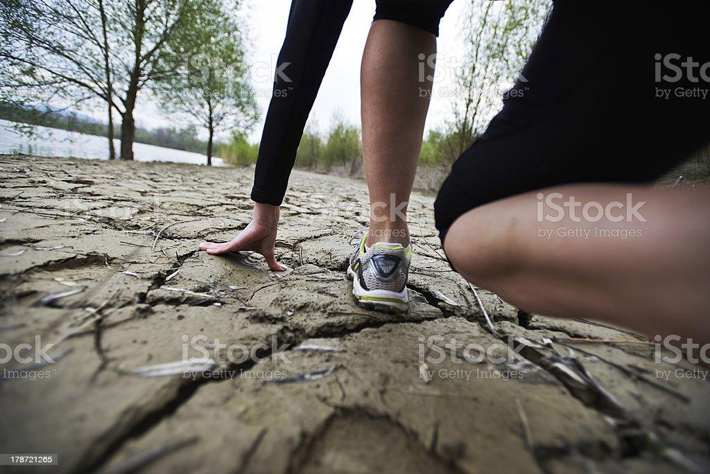 Sporty woman ready in low start stock photo