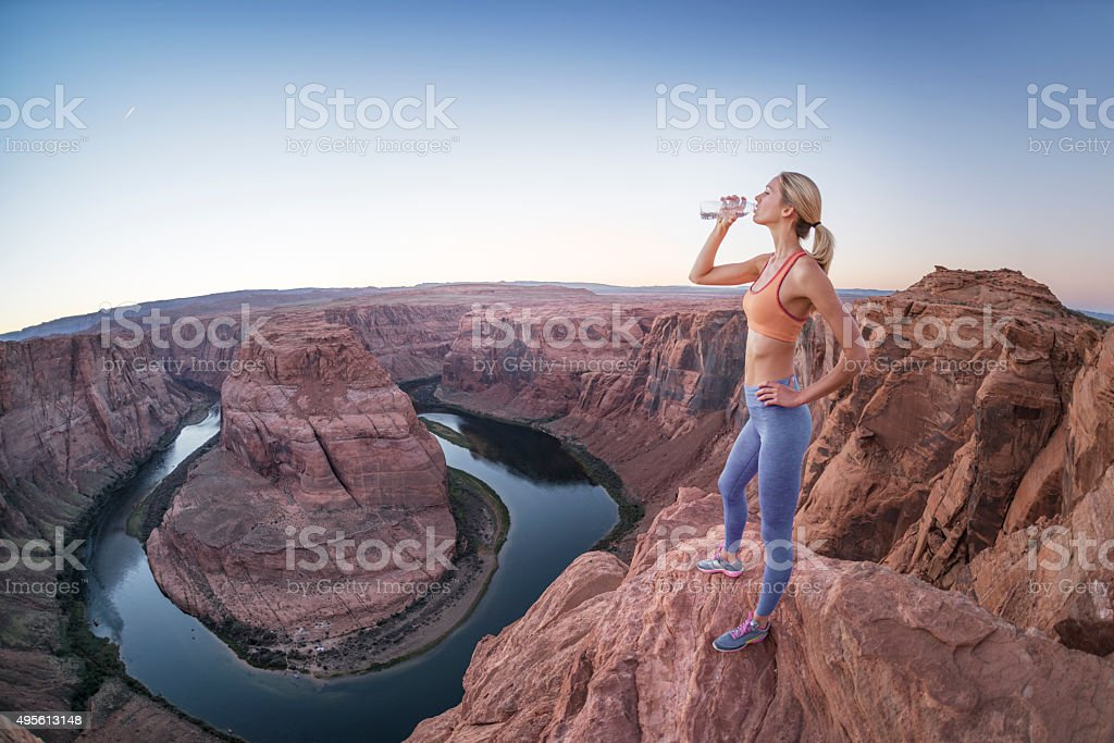 Sporty Woman refreshing, drinking Water at Horseshoe Bend stock photo