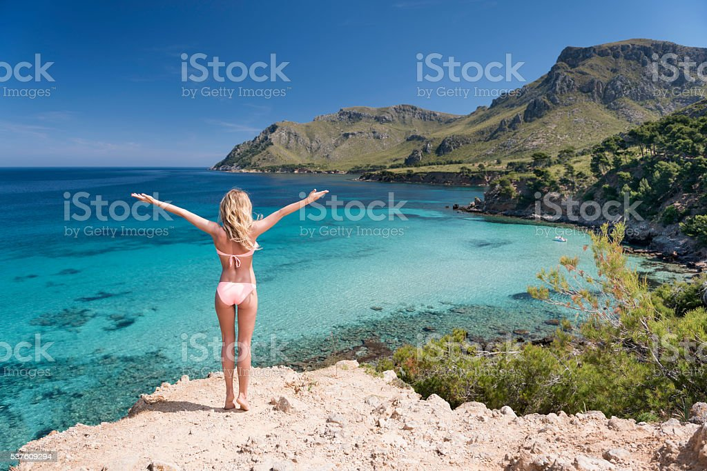 Sporty Woman with Arms apart Feeling Nature, Mallorca, Spain stock photo