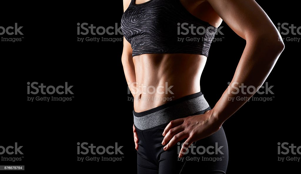Sporty woman with perfect abdomen muscles stock photo