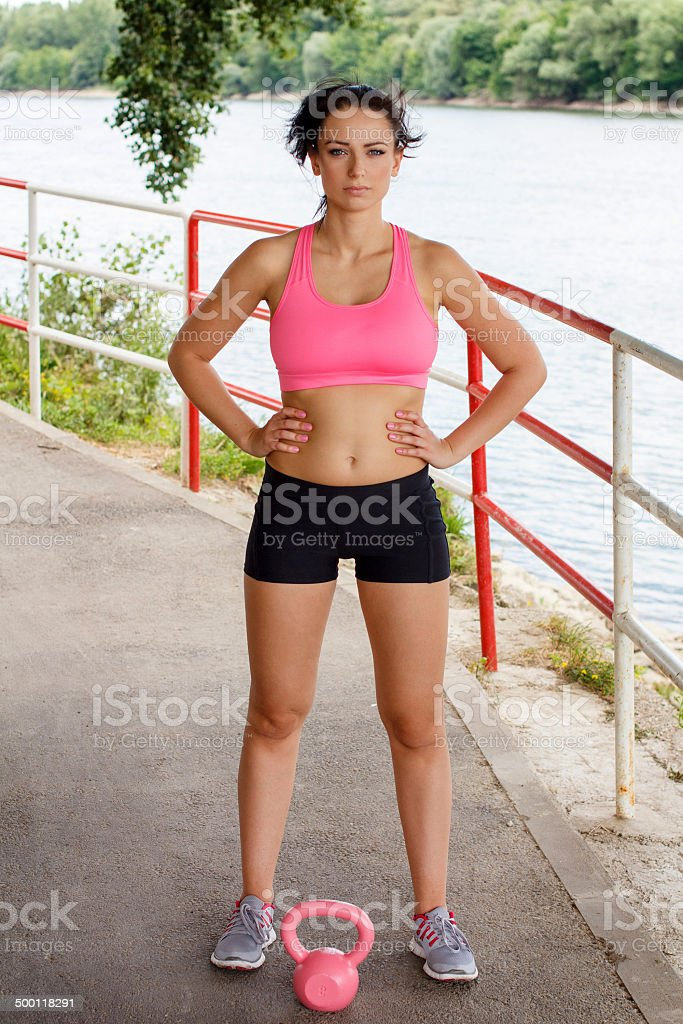 Sporty woman with pink kettlebell royalty-free stock photo