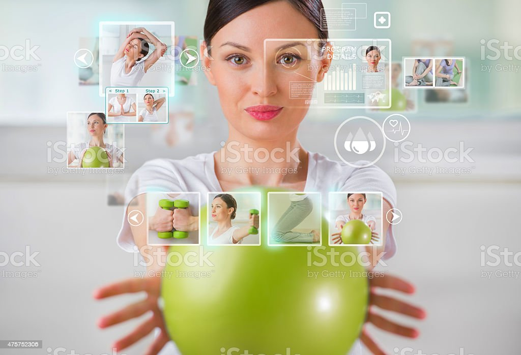 Sporty woman working out using modern virtual interface stock photo