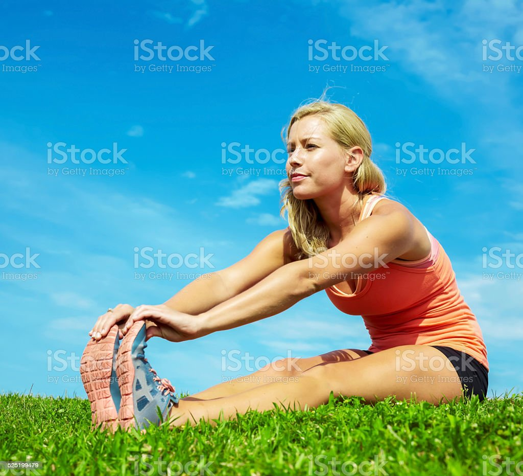 Sporty Young Woman Stretching At Park stock photo
