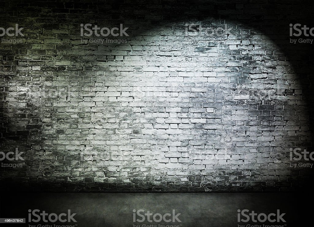 Spot light on old brick wall stock photo