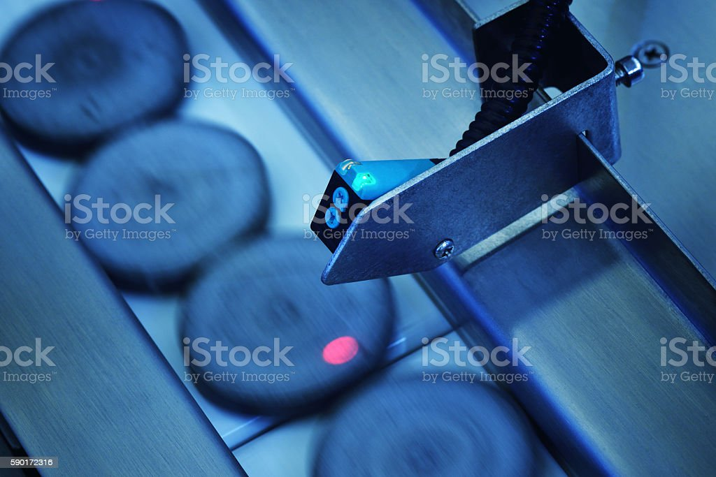 Spot Metering Sensor in the Production Line stock photo